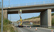 Ring Road Bridge with lane closed and a cherry picker